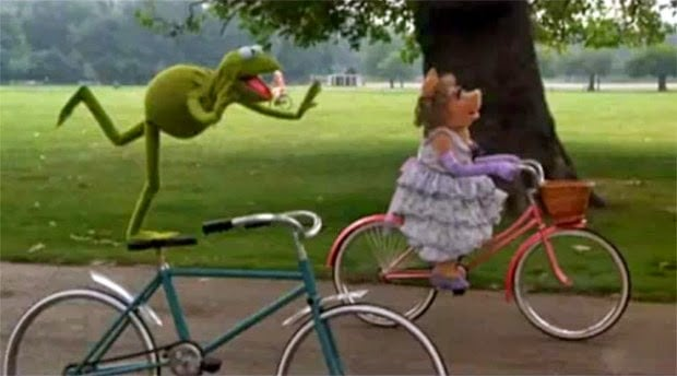 Apparently Kermit rides a brakeless fixie with a purely ornamental front fender.