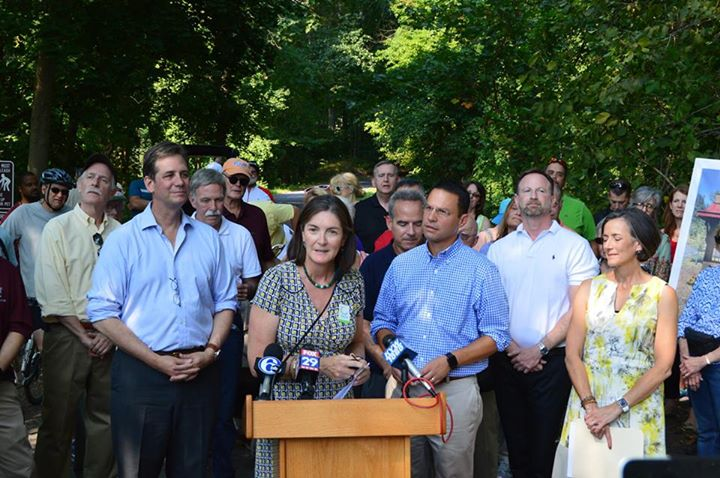 Bicycle Coalition Deputy Director Sarah Clark Stuart speaks at the Pennypack Trail ribbon-cutting.