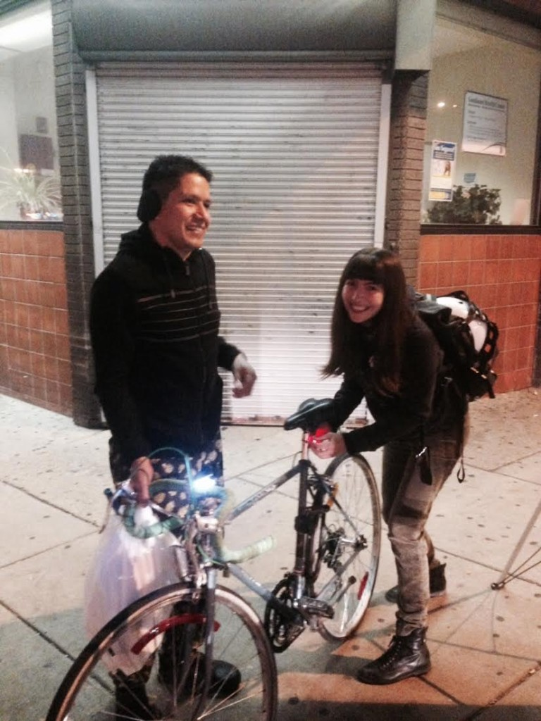 Pati helps a South Philadelphia community member get his new bike light all set up.