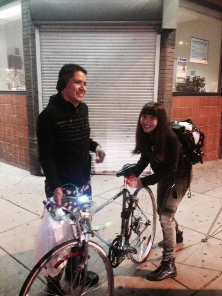 Pati helps a South Philadelphia community member get his new bike light all set up.