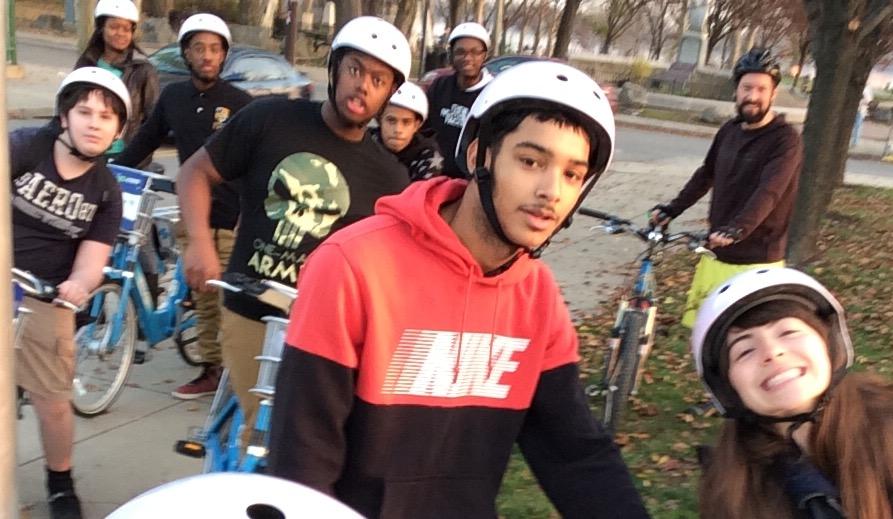Students riding their bikes through Kensington.