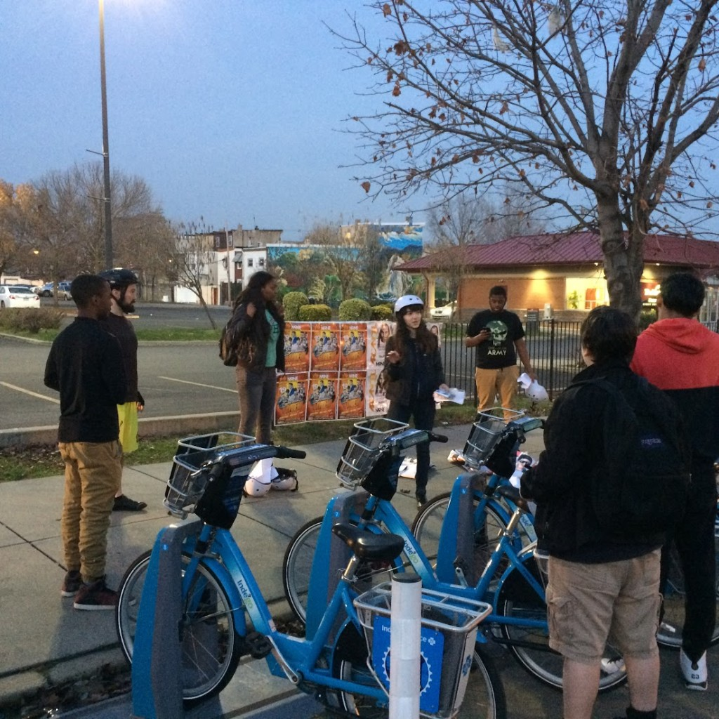 Bicycle Coalition staff member Pati Gutiérrez speaks to the students about being safe on the road.