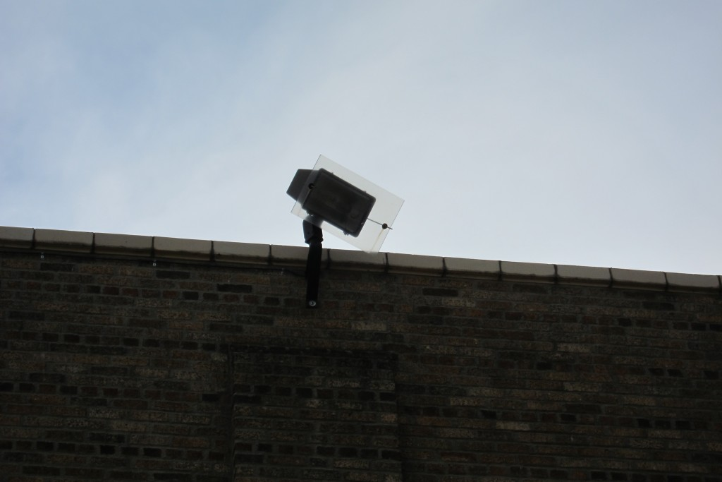 A security camera overlooks the school grounds.