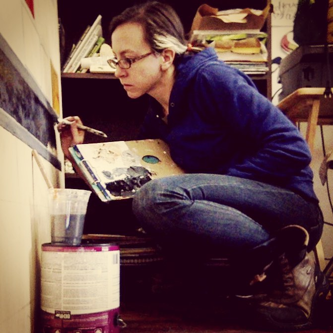 Meg works on the SEPTA mural. (Photo: PHEW)