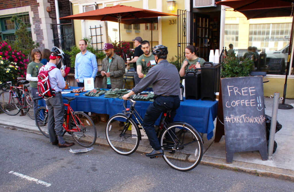 A cyclist stops by an Energizer Station on Bike To Work Day