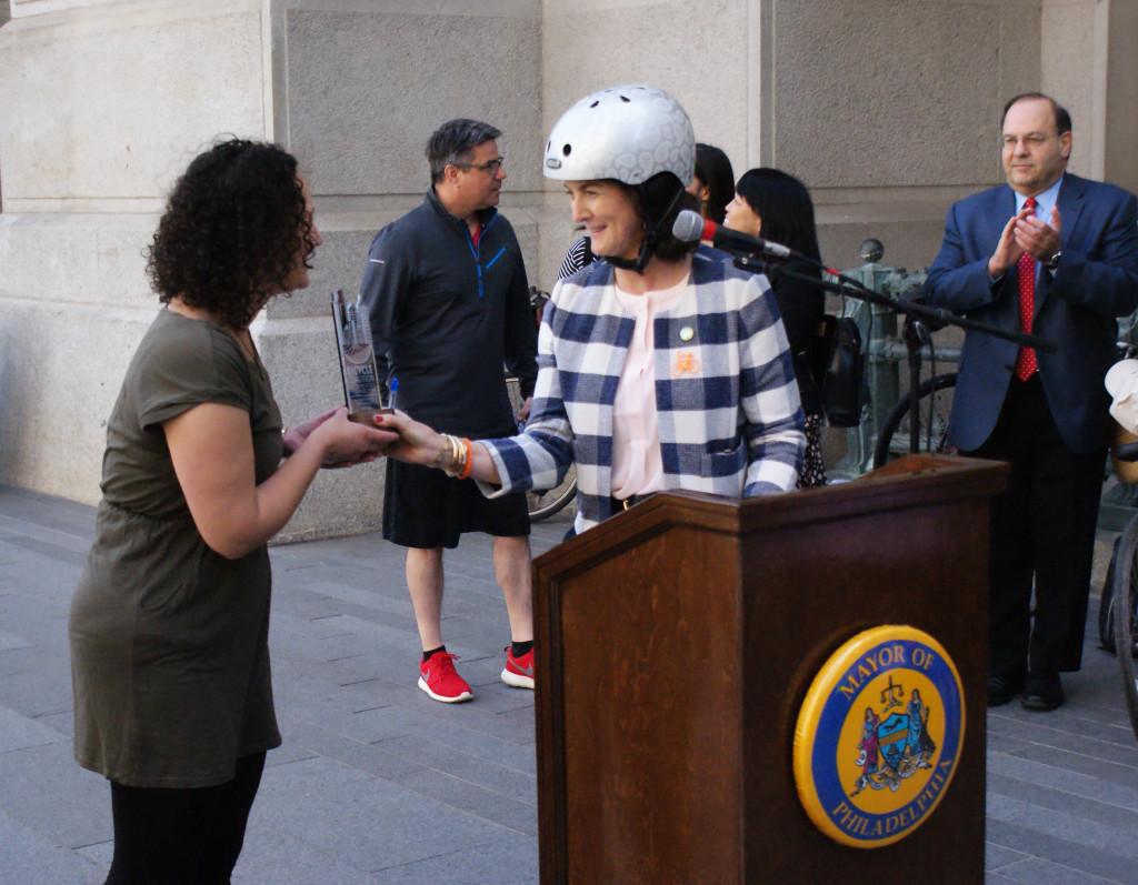 A representative from Ticketleap accepts their Bike-Phriendly Business Award