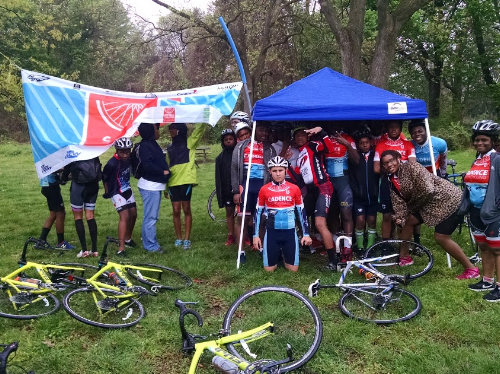 Post race youth decided to get away from the rain by huddling under a tent.