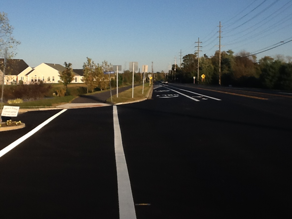 A suburban bike lane and an asphalt sidepath on Academy St in Clayton, NJ
