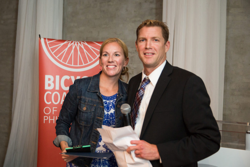 Katie Migliocco of Capital One (left) receives the Cadence Youth Cycling Award, presented by Ryan Oelkers (right), co-founder of Cadence. Capital One is a very important sponsor and partner for Cadence Youth Cycling.