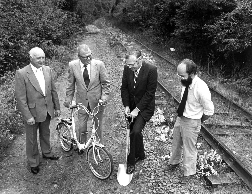 Bob McConnell, the Executive Director of the Fairmount Park Commission (left), two unknown Montgomery County Commissioners, and Jim Campbell of the Southeastern Pennsylvania Sierra Club (right) at the groundbreaking of the Schuylkill River Trail, in 1979.